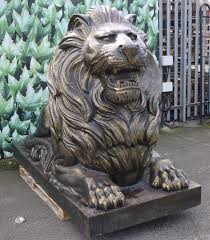 metal lion statue large metal lion garden sculpture garden ornament candle and blue