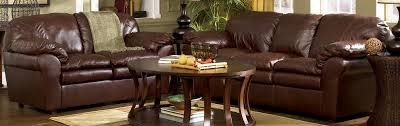 Sofa At Ashley Furniture Axiom Traditional Walnut Leather Wood Sofa Living Rooms The