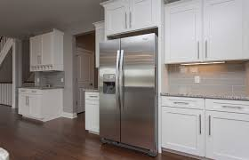 white shaker kitchen cabinets wood floors how to style your white shaker cabinets cabinets