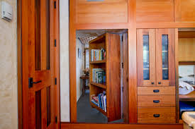 nice looking secret room bookshelf door with grey flooring decor