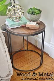 Industrial Accent Table Casual Wood Top Round Accent Table Features An Industrial Metal