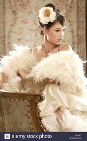 a brunette female wearing a cream satin wedding dress a cream