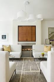 Sparks Fireplace - terrific hideaway tv cabinet with wall mounted television artwork