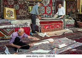 The Carpet Market Worker Sew Underneath To Persian Carpet In The Carpet Shop Tehran