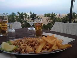 pizzeria il gabbiano calamari e patatine in riva al mare foto di ristorante