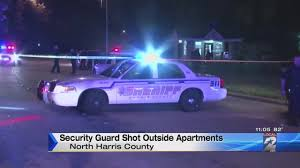 security guard shot outside apartment complex