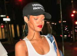 rihanna hoop earrings noel gallagher mocks rihanna s small army of an entourage as riri