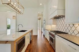 white kitchen backsplash tiles white and gray quatrefoil kitchen backsplash tiles transitional