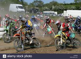 motocross race mayhem at the start and first bend of a youth motocross race at