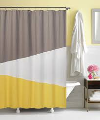 yellow and gray color block shower curtain at home bathroom