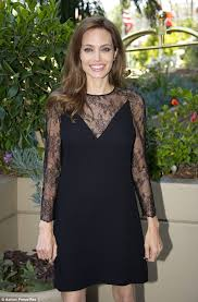 angelina jolie stuns in black lace mini dress and horned heels as