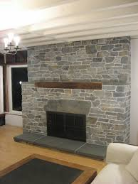 stone fireplace surround noble wooden shelf at neutral stone