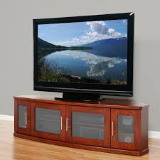 corner tv stand with glass doors plateau newport 62 inch corner tv stand in walnut hayneedle