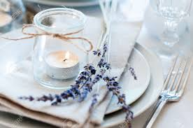 dining table setting at provence style with candles lavender