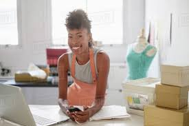 young fashion designer in home office stock photo dissolve