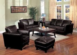 Modern Black Leather Sofa In Living Room Home Design And Ideas - Leather chairs living room