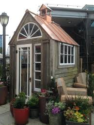 backyard with gravel and wooden small shedsmall garden sheds