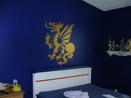 cv designs murals in this room two walls are dark blue and the other two are a blue gray to keep the room from being too dark this young man was very specific about the