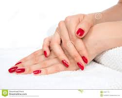 women with red nails hands manicured red nails on a white