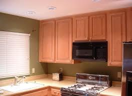 mahogany wood sage green shaker door soffit above kitchen cabinets