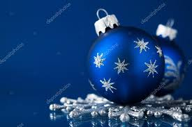 Theme Ornaments Blue And Silver Ornaments On Blue Background With