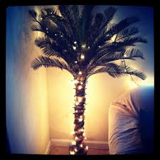 diy lighted palm tree wrap christmas lights around the tree