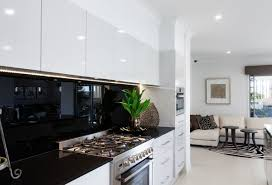 white kitchen cupboards black bench caeserstone jet black benchtop with masters charcoal