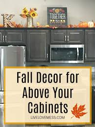 how to decorate above kitchen cabinets for fall fall decor for above your cabinets kibler fall