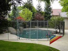 fencing a backyard swimming pool with guardian pool fence systems