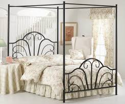 bedroom brown stained oak wood 4 poster canopy bed with curved