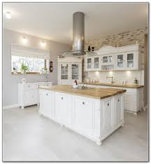 white kitchen island with butcher block top interior design