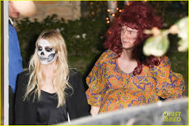 evan peters dresses as pregnant woman for halloween alongside emma