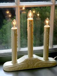 window candles lights in 3 and 5 tiers