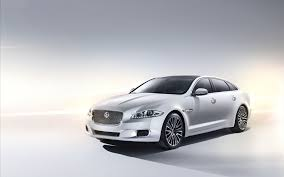 white jaguar car wallpaper hd wallpaper jaguar xj ultimate hd car on white color full image of