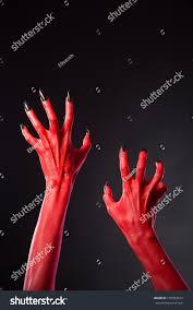 halloween background devil red devil hands black nails halloween stock photo 156593312