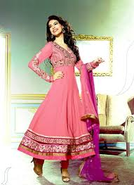 this long anarkali suit with a baby pink color looks very nice the