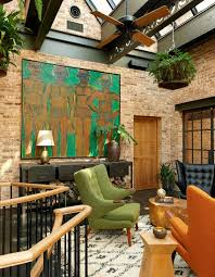living room industrial sunroom with midcentury decor bright wall
