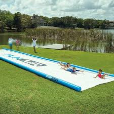 right in your own backyard 50 ft slide lets you have a mini water park right in your own backyard