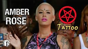 amber rose gets upside down crucifix tattoo on her forehead