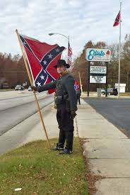 Aryan Nation Flag Group Rallies Near Local Business To Show Support For Flying Flag