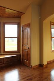 Replacing Wood Paneling by Interior Doors Arch Top Two Panel Knotty Alder Doors Create A