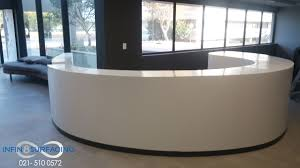 Rounded Reception Desk by Our Solid Surface Work Infin8 Surfacing