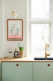 stylish ikea hack kitchen with mint green cabinet fronts by reform