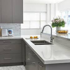 gray kitchen cabinets with white granite white granite design ideas