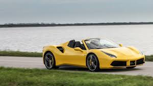 ferrari yellow and black 2016 ferrari 488 spider review and road test with horsepower