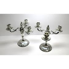 candelieri in argento due candelieri in argento 800 a tre fuochi cesellati a mano