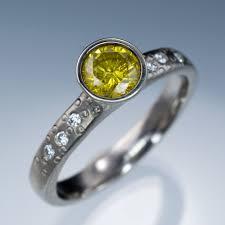 palladium engagement rings peekaboo bezel set yellow diamond dust palladium engagement ring