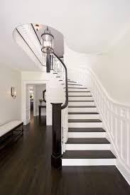 ohio valley flooring for a traditional staircase with a curved