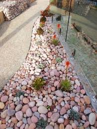 how to make a flower bed into a river rock garden house ideas