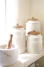 beige fleur de lis ceramic kitchen canisters set 3 by traditional canister set 3 pc fleur de lis antique french country